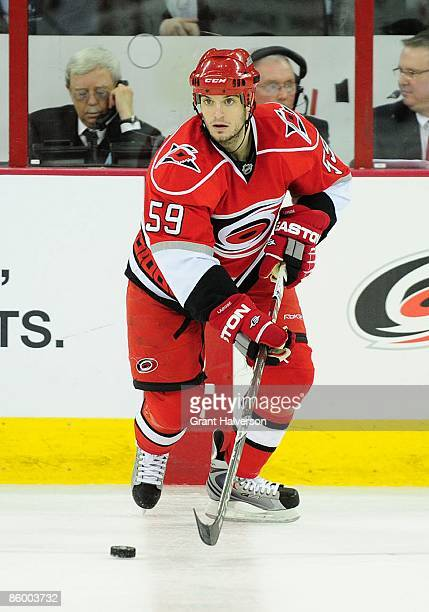 Chad LaRose of the Carolina Hurricanes controls the puck during the NHL game against the Ottawa Senators at the RBC Center on March 25, 2009 in...