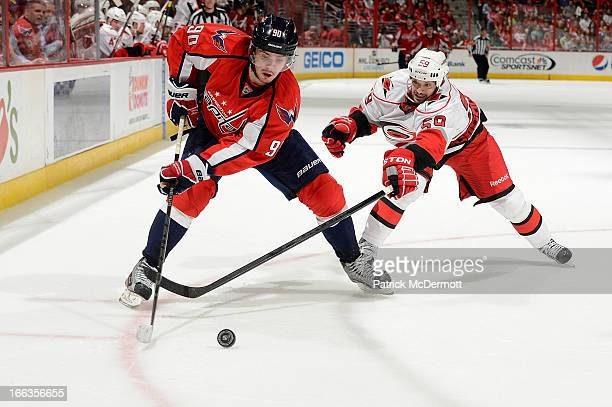 Chad LaRose of the Carolina Hurricanes defends against Marcus Johansson of the Washington Capitals during the third period of an NHL game at Verizon...