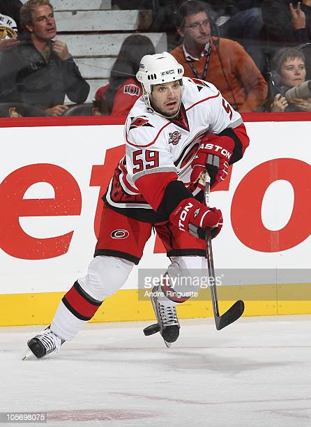 Chad LaRose of the Carolina Hurricanes passes the puck against the Ottawa Senators at Scotiabank Place on October 14 2010 in Ottawa Ontario Canada
