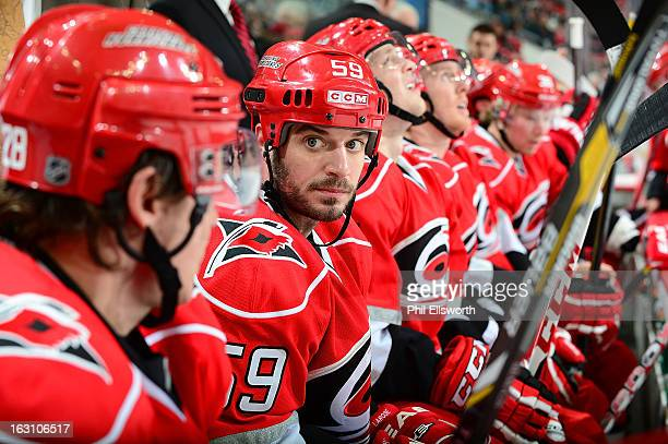 Chad LaRose of the Carolina Hurricanes rests on the bench during an NHL game against the Pittsburgh Penguins on February 28 2013 at PNC Arena in...