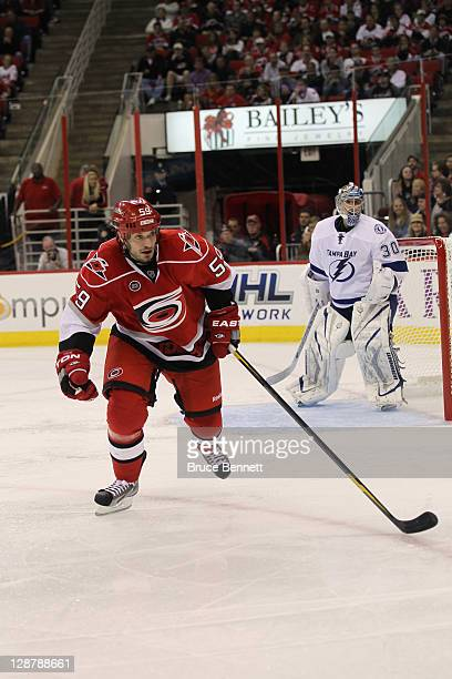 Chad LaRose of the Carolina Hurricanes skates against the Tampa Bay Lightning at the RBC Center on October 7 2011 in Raleigh North Carolina The...