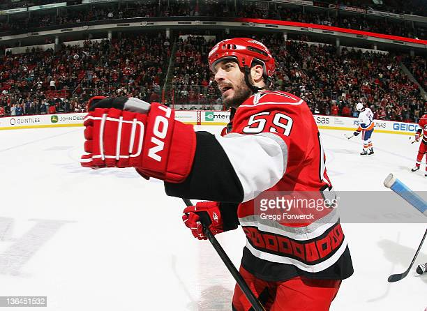 Chad LaRose of the Carolina Hurricanes skates back to the bench after scoring a game tying goal against the New York Islanders during an NHL game on...