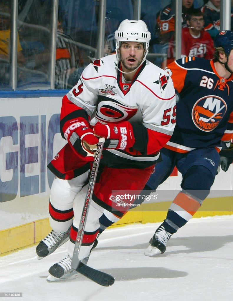 Chad LaRose #59 of the Carolina Hurricanes skates behind the net during the NHL game against the New York Islanders on January 21, 2008 at Nassau Coliseum in Uniondale, New York. The Hurricanes defeated the Islanders 3-2 in overtime.