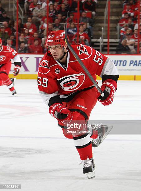 Chad LaRose of the Carolina Hurricanes skates for position on the ice against the Tampa Bay Lightning during a NHL game on October 7 2011 at RBC...