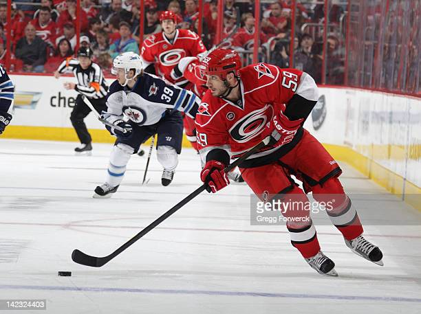 Chad LaRose of the Carolina Hurricanes skates with the puck against the Winnipeg Jets during an NHL game on March 30 2012 at PNC Arena in Raleigh...