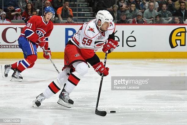 Chad LaRose of the Carolina Hurricanes skates with the puck during the NHL game against the Montreal Canadiens on February 26 2011 at the Bell Centre...