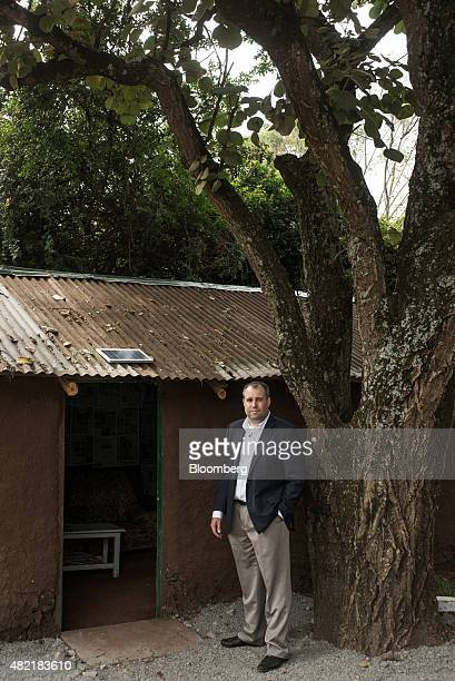 Chad Larson cofounder and finance director of MKopa Solar poses for a photograph outside a hut with a solar panel at the headquarters of MKopa Solar...