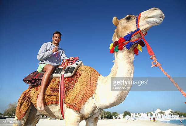 Chad le Clos, FINA Male Swimmer of the Year 2014, rides a camel prior to the start of the Abu Dhabi Swimming Festival by Daman's ActiveLife at...