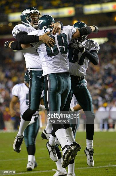 Chad Lewis of the Philadelphia Eagles celebrates his first quarter touchdown reception with teammates Freddie Mitchell and Todd Pinkston as the...