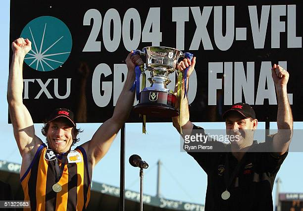 Chad Liddell and Mark Williams coach of the Zebras hold aloft the Premiership Cup after the VFL Grand Final between The Sandringham Zebras and the...