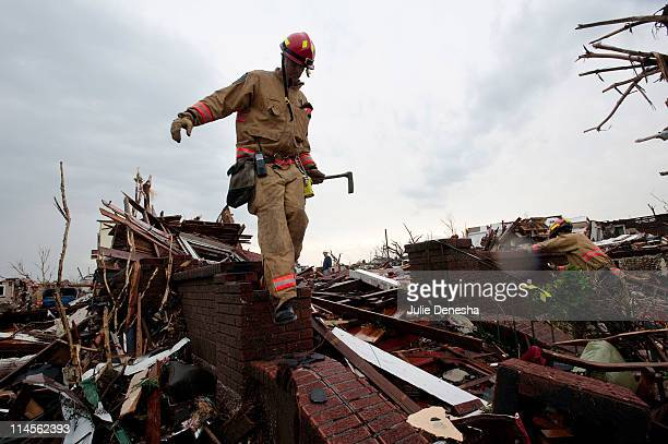 Chad Lunt of the Kansas City Fire Department Rescue Team travels house-to-house to look for survivors on May 23, 2011 in Joplin, Missouri. A powerful...