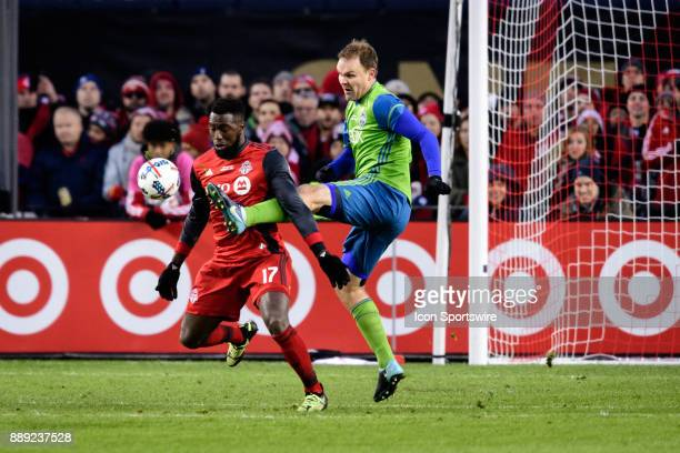 Chad Marshall of Seattle Sounders FC kicks the ball away from Jozy Altidore of Toronto FC during the 2017 MLS Cup Final between Toronto FC and...