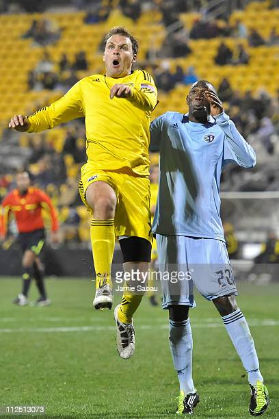 Chad Marshall of the Columbus Crew and Birahim Diop of Sporting Kansas City battle for position on a loose ball on April 16 2011 at Crew Stadium in...