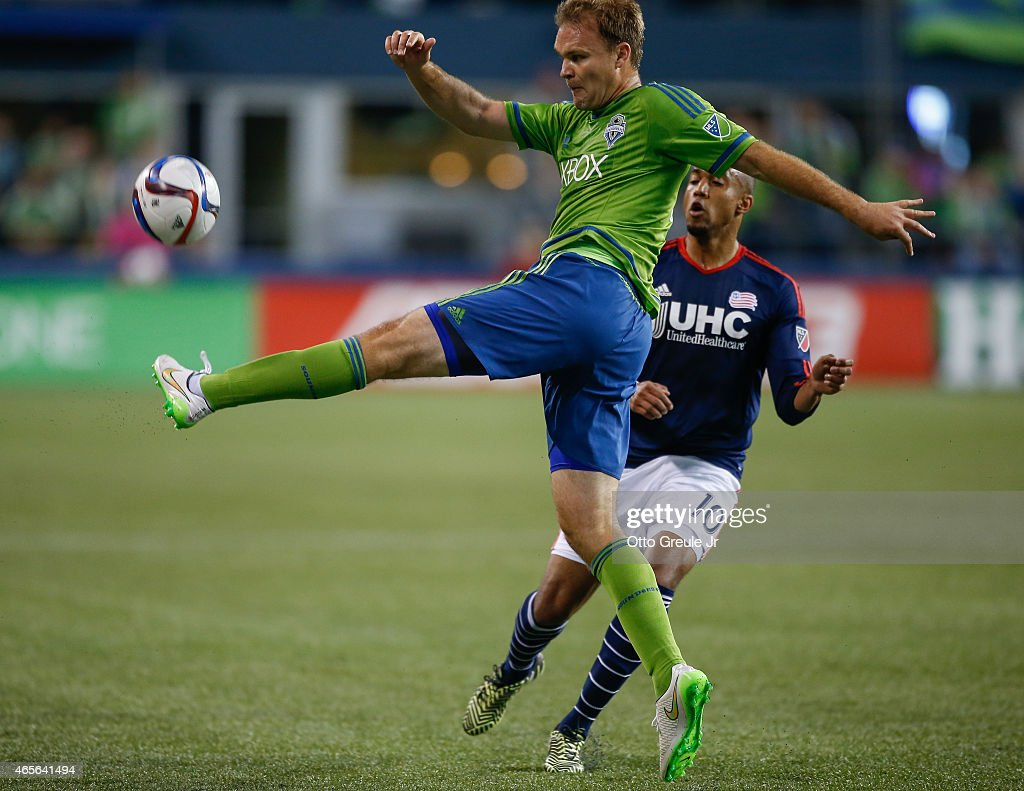 Chad Marshall #14 of the Seattle Sounders FC passes against Teal Bunbury #10 of the New England Revolution at CenturyLink Field on March 8, 2015 in Seattle, Washington. The Sounders defeated the Revolution 3-0.