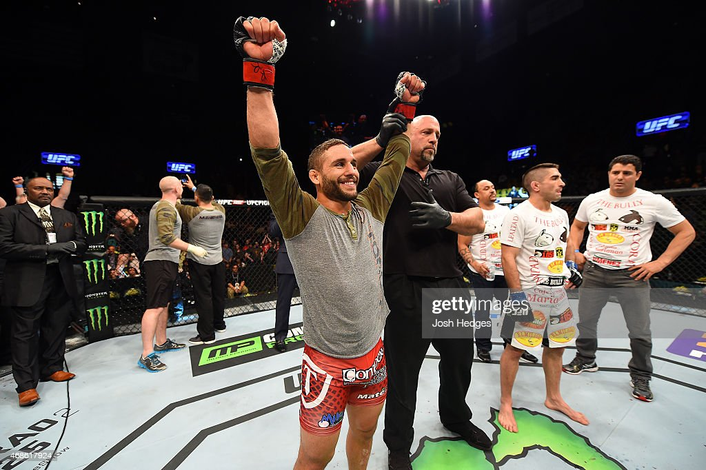 Chad Mendes celebrates after defeating Ricardo Lamas in their featherweight fight during the UFC Fight Night event at the Patriot Center on April 4, 2015 in Fairfax, Virginia.
