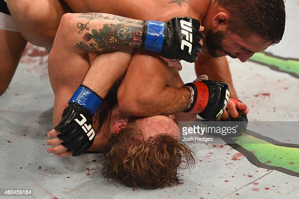 Chad Mendes elbows Conor McGregor in their UFC interim featherweight title fight during the UFC 189 event inside MGM Grand Garden Arena on July 11...