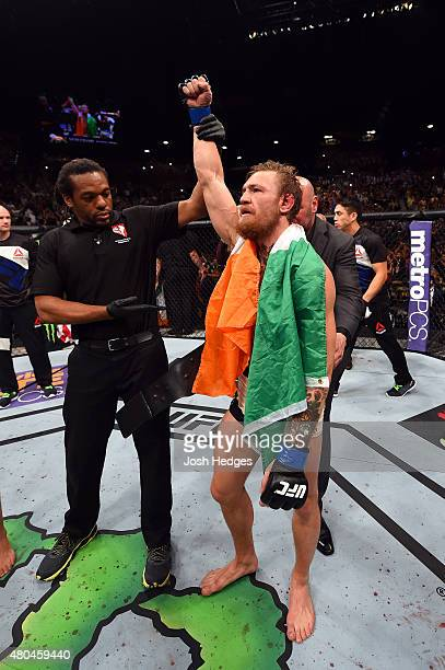 Chad Mendes reacts to his victory over Chad Mendes in their UFC interim featherweight title fight during the UFC 189 event inside MGM Grand Garden...