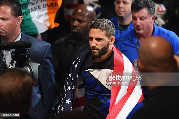 Chad Mendes walks to the Octagon to face Conor McGregor in their UFC interim featherweight title fight during the UFC 189 event inside MGM Grand...