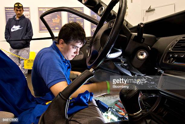 Chad Monte left watches as Best Buy employee Paul Ortman installs an alarm system in his car at a Best Buy store Columbus Ohio US on Wednesday Sept...