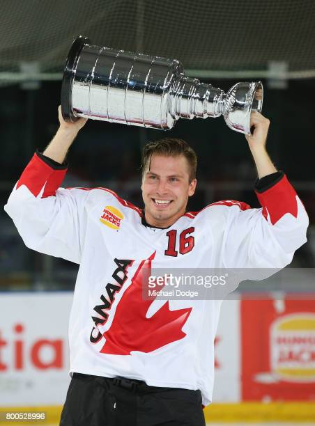 Chad Nehring of Canada holds up the trophy after they won the series during the Ice Hockey Classic match between the United States of America and...