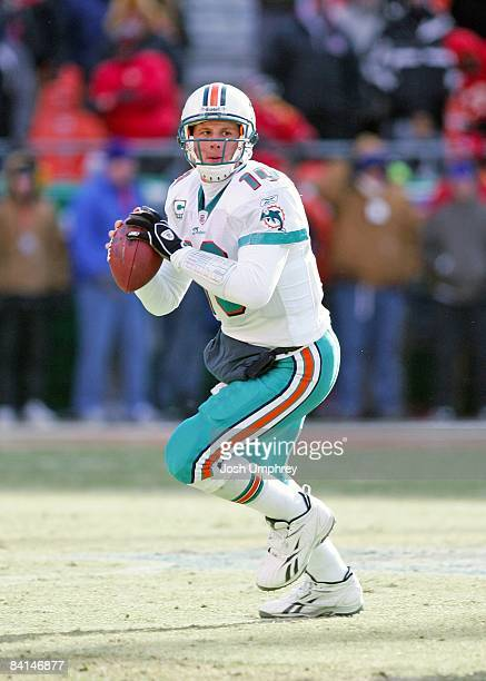 Chad Pennington of the Miami Dolphins looks for a receiver during the game against the Kansas City Chiefs at Arrowhead Stadium on December 21 2008 in...