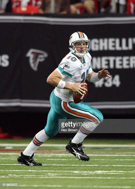 Chad Pennington of the Miami Dolphins rolls out looking to pass against the Atlanta Falcons at Georgia Dome on September 13 2008 in Atlanta Georgia...