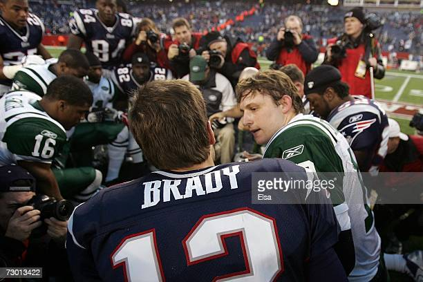 Chad Pennington of the New York Jets and Tom Brady of the New England Patriots take a knee after their AFC Wild Card Playoff Game at Gillette Stadium...