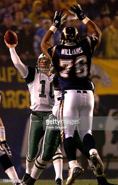 Chad Pennington of the New York Jets gets off a pass despite the efforts of Jamal Williams of the San Diego Chargers in the firsthalf of the AFC Wild...
