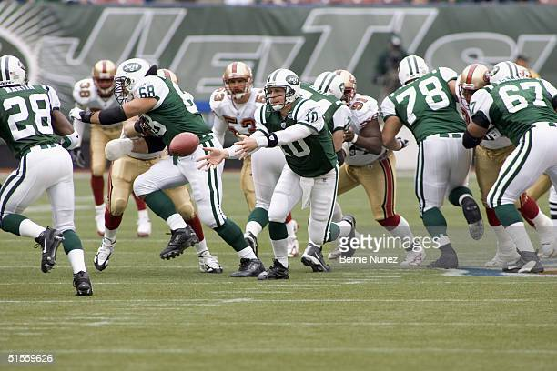 Chad Pennington of the New York Jets pitching out to RB Curtis Martin in the game against the San Francisco 49ers on October 17, 2004 at Giants...