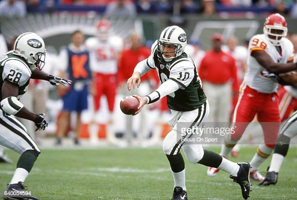 Chad Pennington of the New York Jets turns to handoff to running back Curtis Martin against the Kansas City Chiefs during an NFL football game...