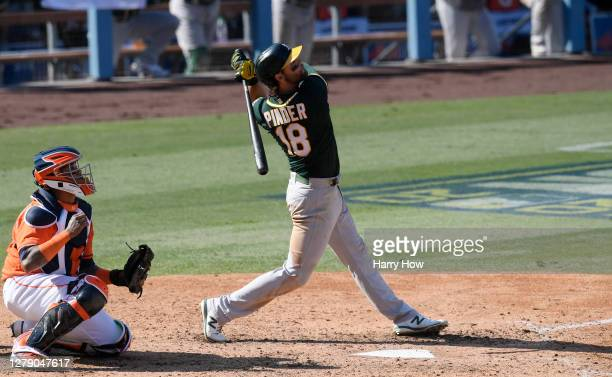 Chad Pinder of the Oakland Athletics hits a three run home run against the Houston Astros during the seventh inning in Game Three of the American...