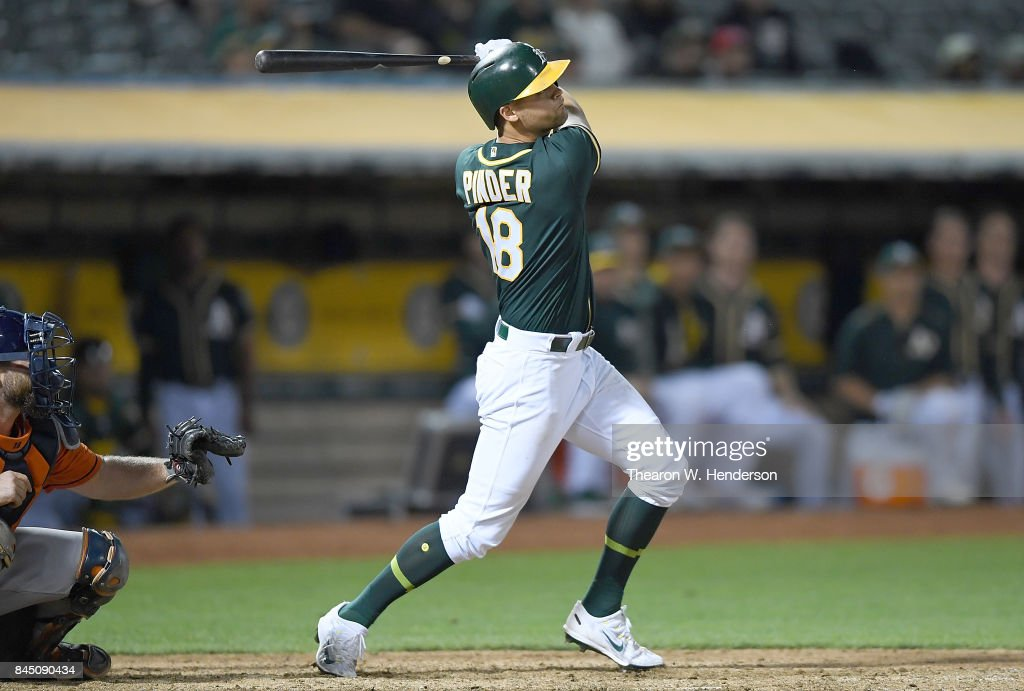 Chad Pinder #18 of the Oakland Athletics hits a three-run homer against the Houston Astros in the bottom of the eighth inning of the second game in a double header at Oakland Alameda Coliseum on September 9, 2017 in Oakland, California.