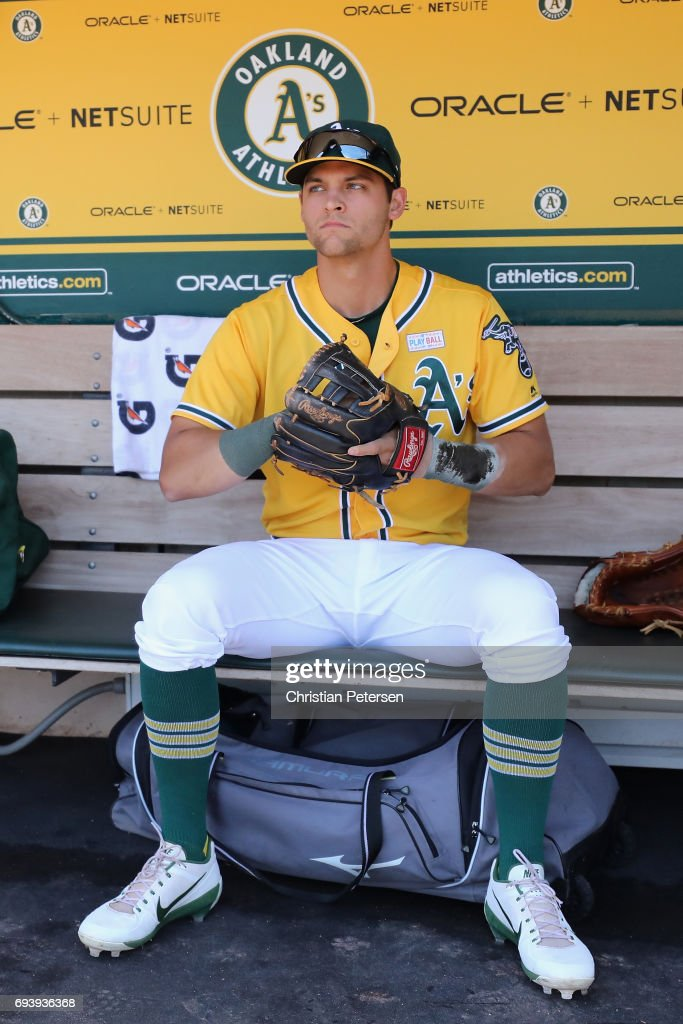 Chad Pinder #18 of the Oakland Athletics sits in the dugout before the MLB game against the Washington Nationals at Oakland Coliseum on June 3, 2017 in Oakland, California.