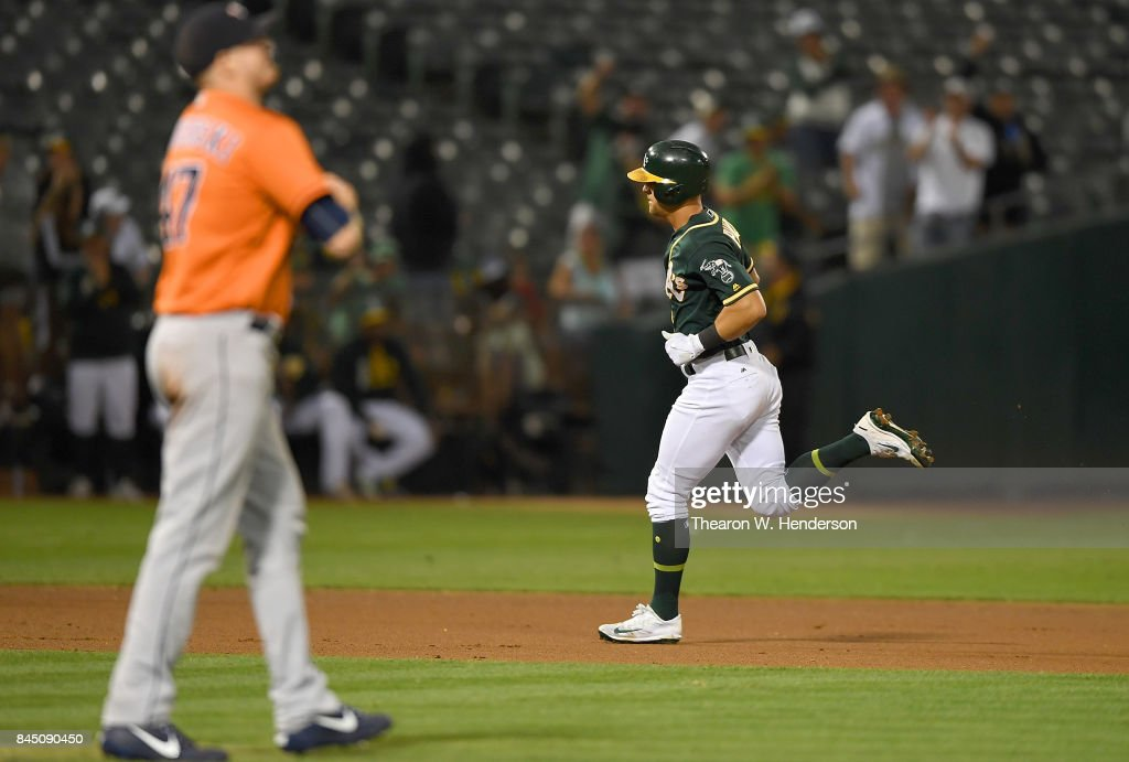 Chad Pinder #18 of the Oakland Athletics trots around the bases after hitting a solo home run off of Chris Devenski #47 of the Houston Astros in the bottom of the seventh inning of the second game in a double header at Oakland Alameda Coliseum on September 9, 2017 in Oakland, California.