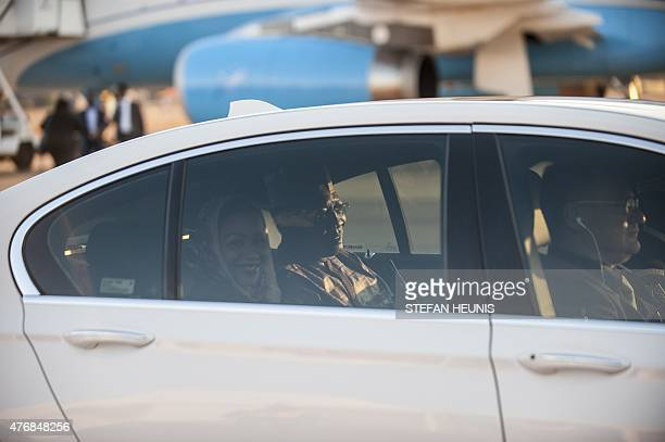 Chad President Idriss Deby Itno and his wife Hinda sit in a car after arriving at the Waterkloof Air Force base in Pretoria on June 12 2015 Heads of...