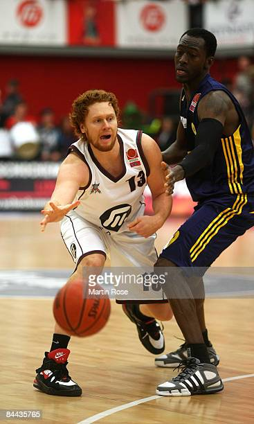 Chad Prewitt of the Dragons battles for the ball with Ansu Sesay of Berlin during the Basketball Bundesliga match between Artland Dragons and Alba...