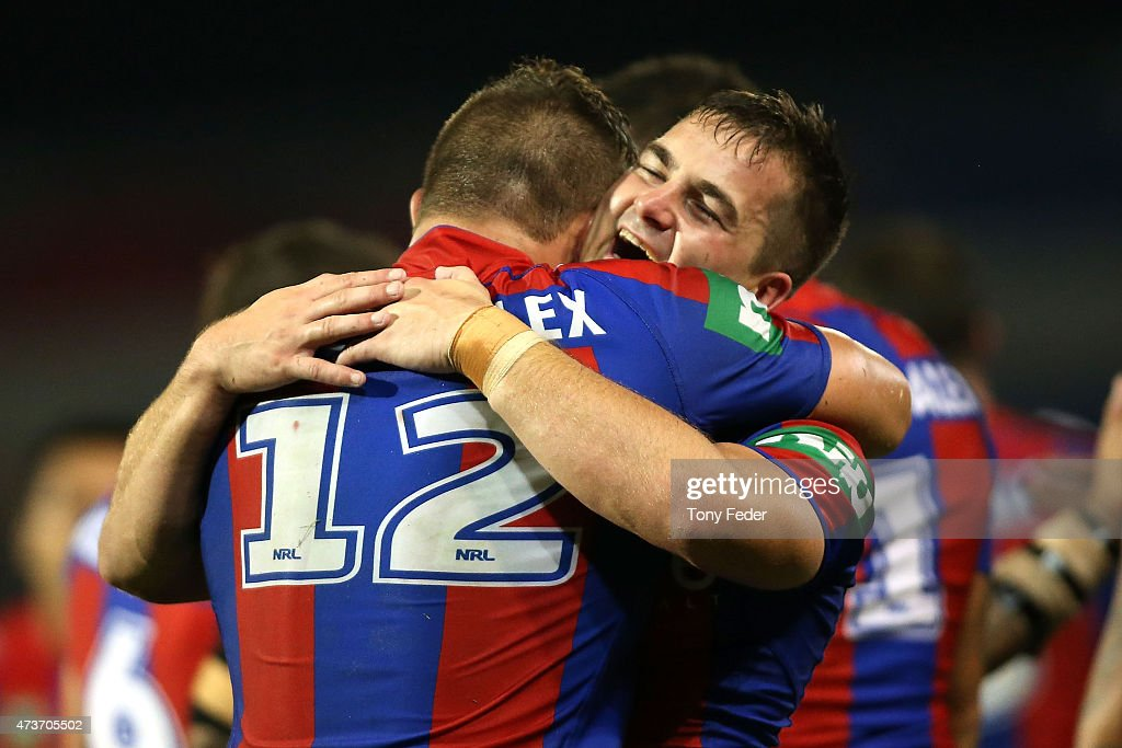 Chad Redman of the Knights celebrates a try with team mate Tariq Sims during the round 10 NRL match between the Newcastle Knights and the Wests Tigers at Hunter Stadium on May 17, 2015 in Newcastle, Australia.