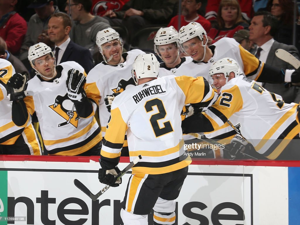 official photos 5ed4d 355c4 Chad Ruhwedel of the Pittsburgh Penguins is congratulated as ...