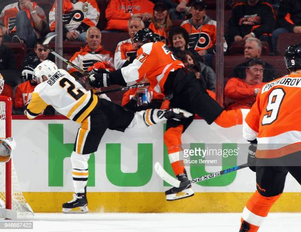 Chad Ruhwedel of the Pittsburgh Penguins is hit by Wayne Simmonds of the Philadelphia Flyers during the third period in Game Three of the Eastern...