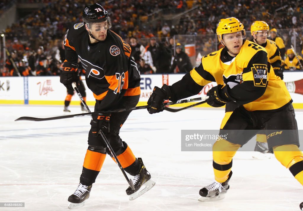 Chad Ruhwedel #2 of the Pittsburgh Penguins ties up Chris VandeVelde #76 of the Philadelphia Flyers in the first period of the 2017 Coors Light NHL Stadium Series at Heinz Field on February 25, 2017 in Pittsburgh, Pennsylvania.