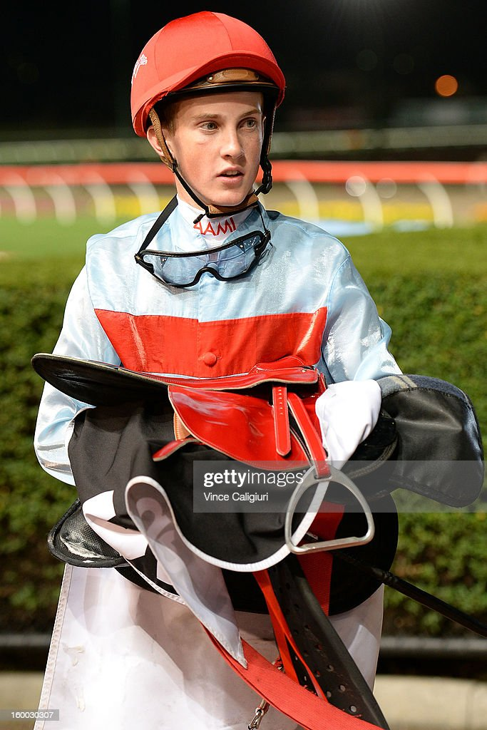Chad Schofield looks on after winning Alternate Railway Tour of Victoria Distance Final during Melbourne racing at Moonee Valley Racecourse on January 25, 2013 in Melbourne, Australia.