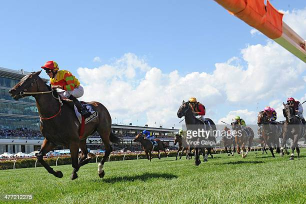 Chad Schofield riding Lankan Rupee defeats Michael Rodd riding Spirit of Boom and Tim Clark riding Knoydart in Race 6 the Lexus Newmarket Handicap...