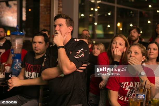Chad Schrage and other Atlanta Falcons fans react while watching Super Bowl 51 against the New England Patriots at STATS on February 5 2017 in...