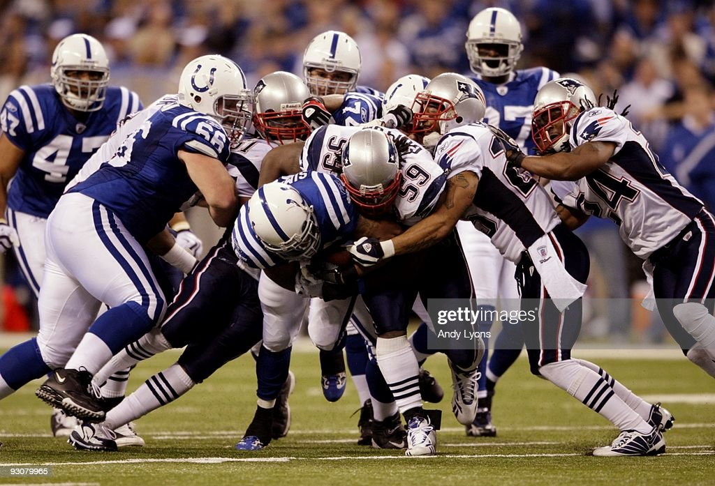 Chad Simpson #35 of the Indianapolis Colts holds on to the ball against Gary Guyton #59 of the New England Patriots during the game at Lucas Oil Stadium on November 15, 2009 in Indianapolis, Indiana.
