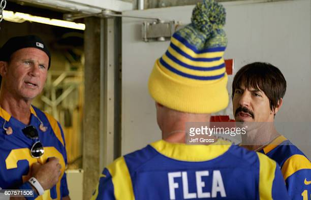 Chad Smith Flea and Anthony Kiedis of the Red Hot Chili Peppers wait backstage before performing at the start of the Los Angeles Rams home opening...