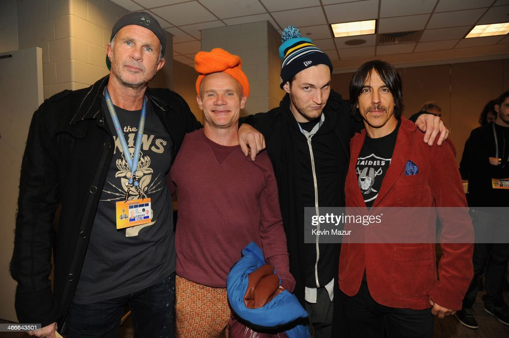 Chad Smith, Flea, Josh Klinghoffer, and Anthony Kiedis of the Red Hot Chili Peppers pose backstage at the Pepsi Super Bowl XLVIII Halftime Show at MetLife Stadium on February 2, 2014 in East Rutherford, New Jersey.