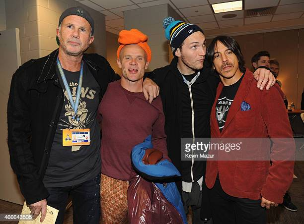 Chad Smith Flea Josh Klinghoffer and Anthony Kiedis of the Red Hot Chili Peppers pose backstage at the Pepsi Super Bowl XLVIII Halftime Show at...