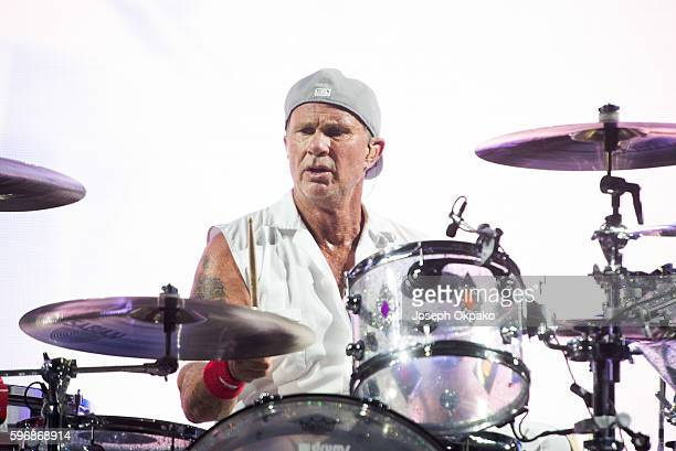 Chad Smith of Red Hot Chili Peppers performs on stage on Day 2 at Reading Festival 2016 on August 27 2016 in Reading England