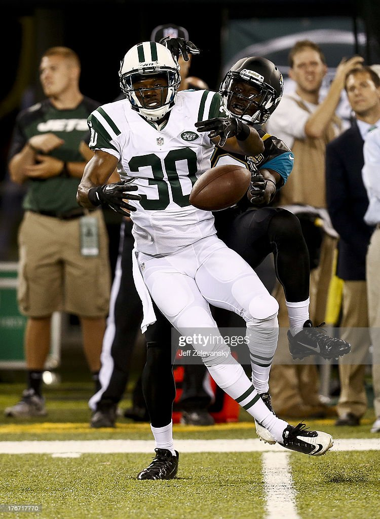 Chad Spann #30 of the New York Jets tries to break up a pass for Mohamed Massaquoi #13 of the Jacksonville Jaguars during their preseason game at MetLife Stadium on August 17, 2013 in East Rutherford, New Jersey.