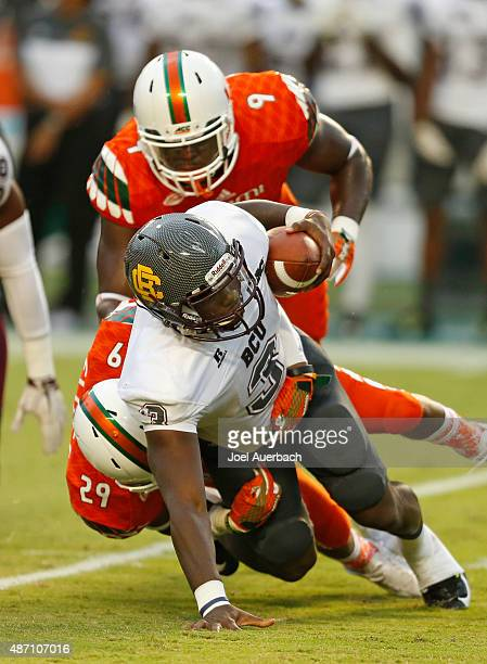 Chad Thomas and Corn Elder of the Miami Hurricanes sack Quentin Williams of the Bethune-Cookman Wildcats on September 5, 2015 at Sun Life Stadium in...